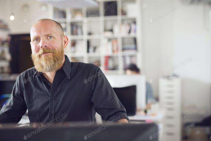 Mature man looking at camera