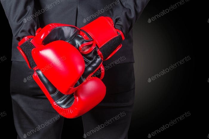 Businessman with boxing glove
