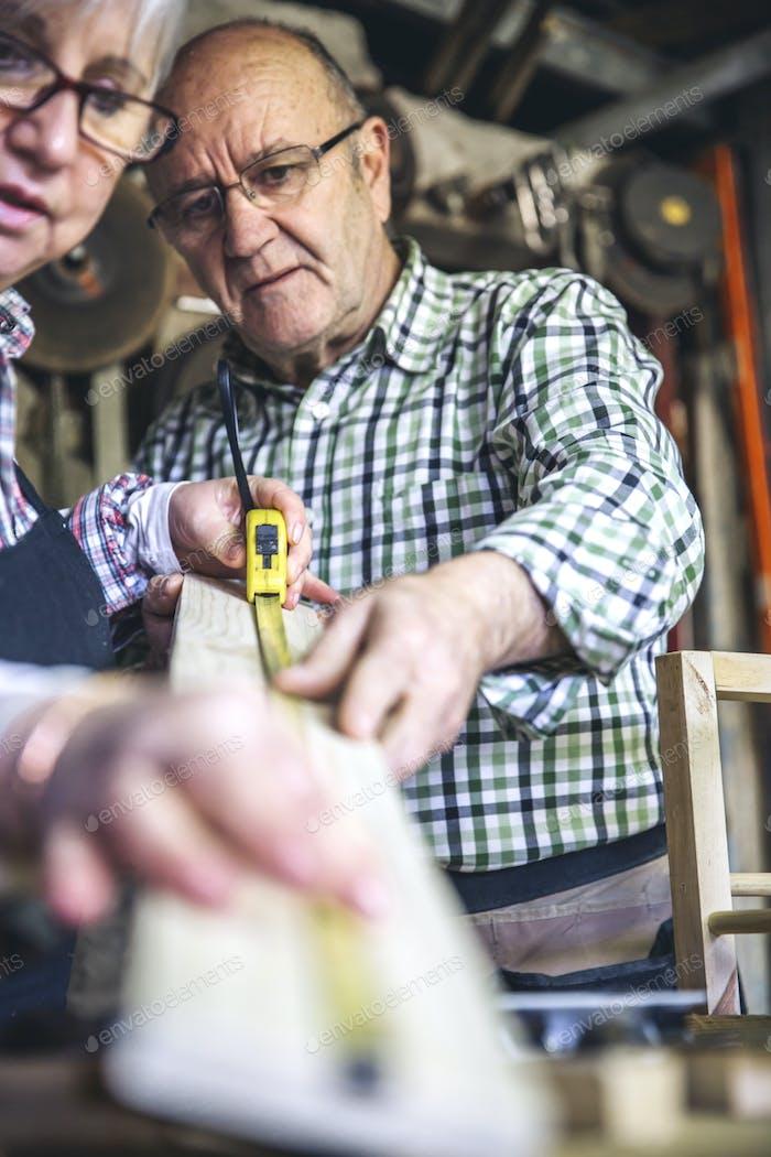 Senior couple in a carpentry