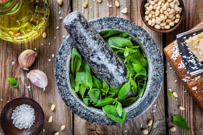 ingredients for pesto: basil, parmesan, pine nuts, garlic, olive oil and salt