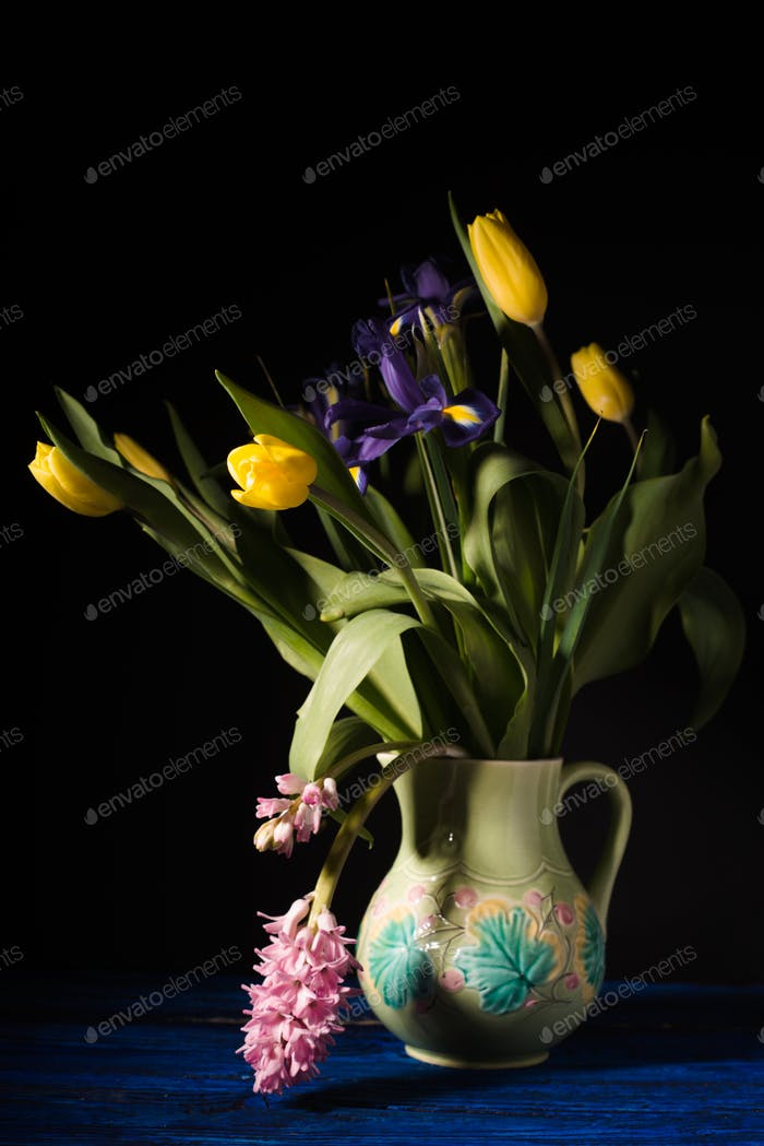 Bouquet of flowers in a ceramic jug side view
