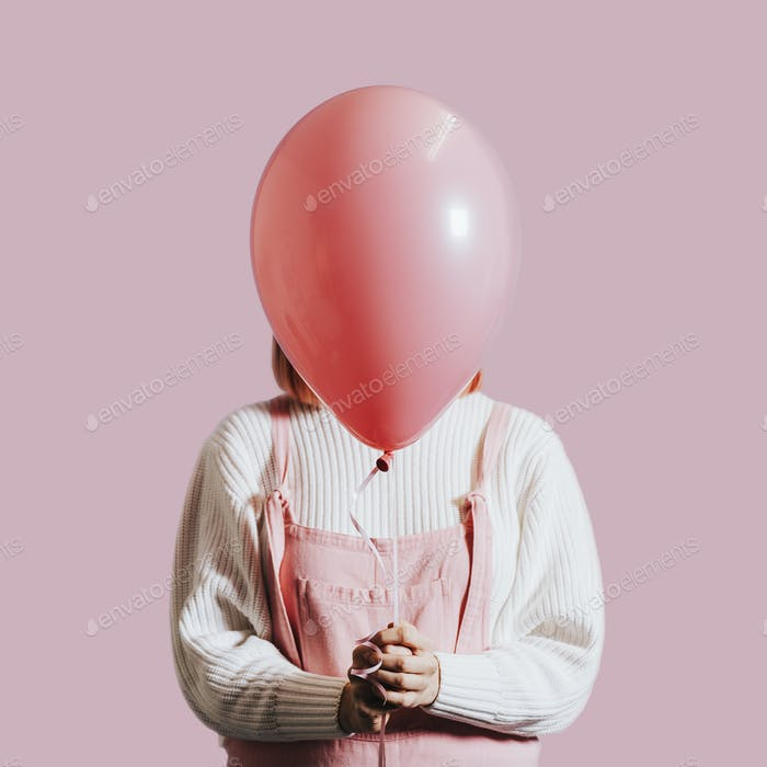 Girl with a pink helium balloon