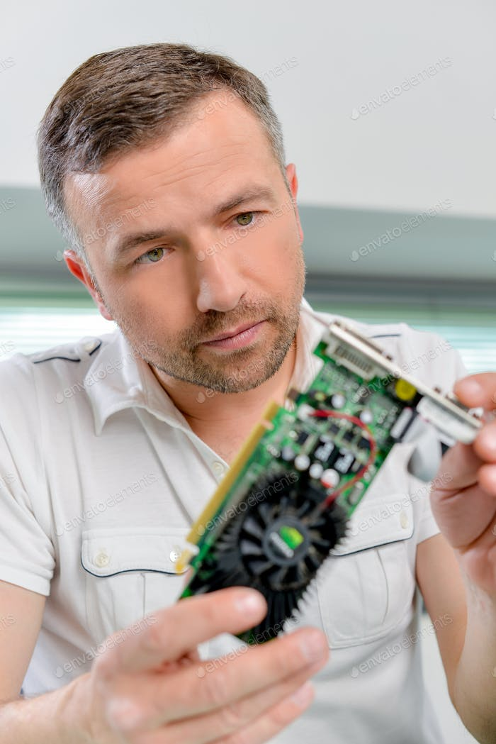 Computer specialist looking at a video card