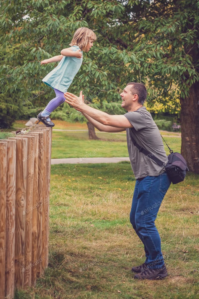 Father catching daughter