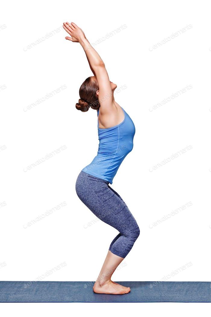 Woman doing ashtanga vinyasa yoga asana Utkatasana - chair pose