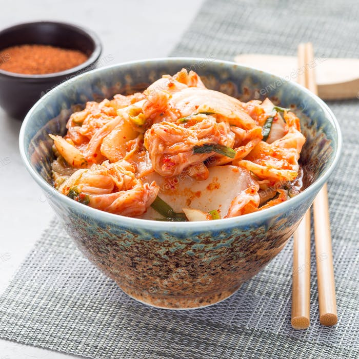 Kimchi cabbage. Korean appetizer in a bowl, square