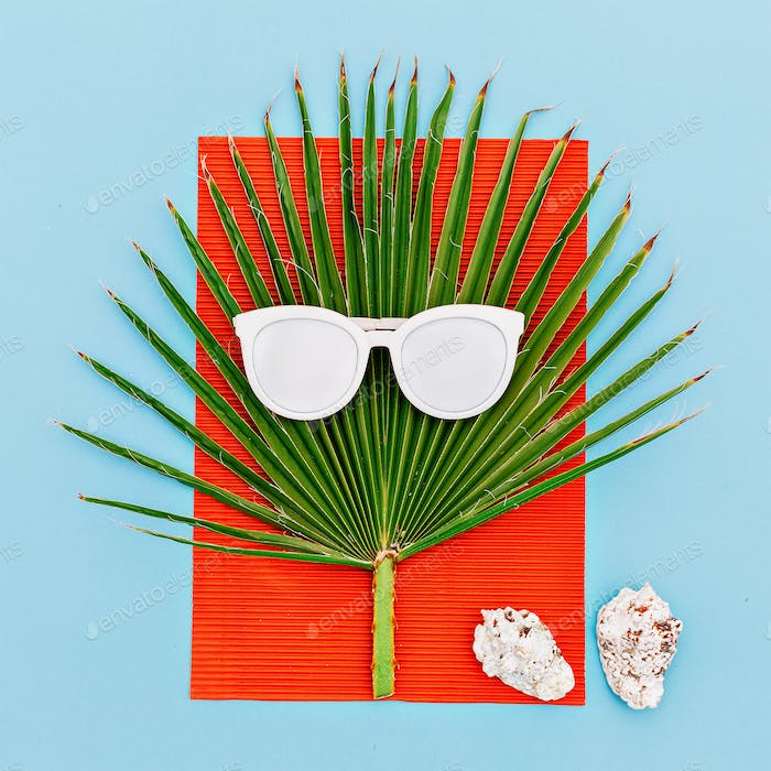 Sea tropical style. Palms and seashells. Sunglasses. Minimal art