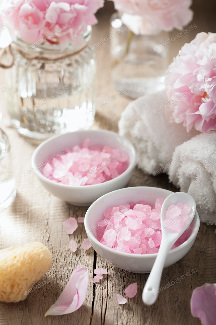 spa set with peony flowers and pink herbal salt