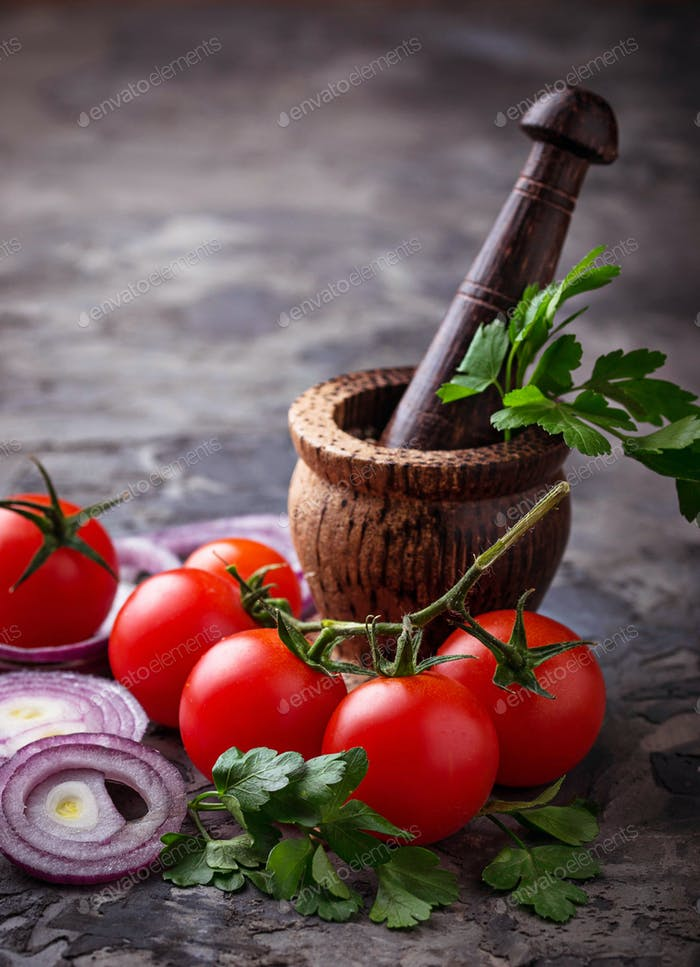 Cherry tomatoes, red onion and  mortar for spices