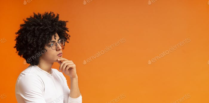 Pensive black guy thinking about solution of problem