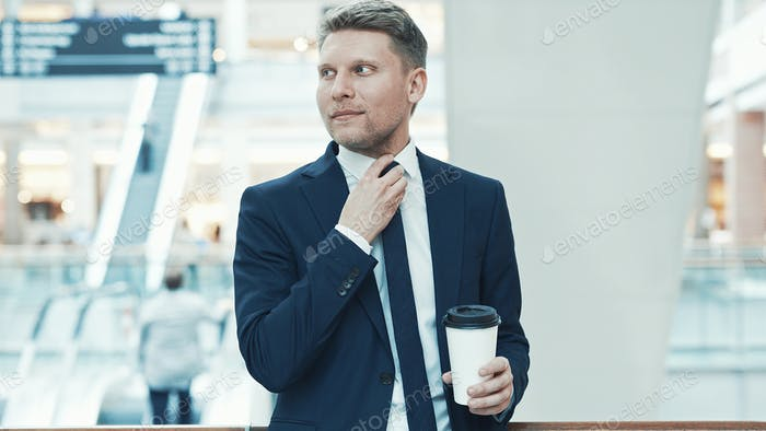 Young businessman with coffee