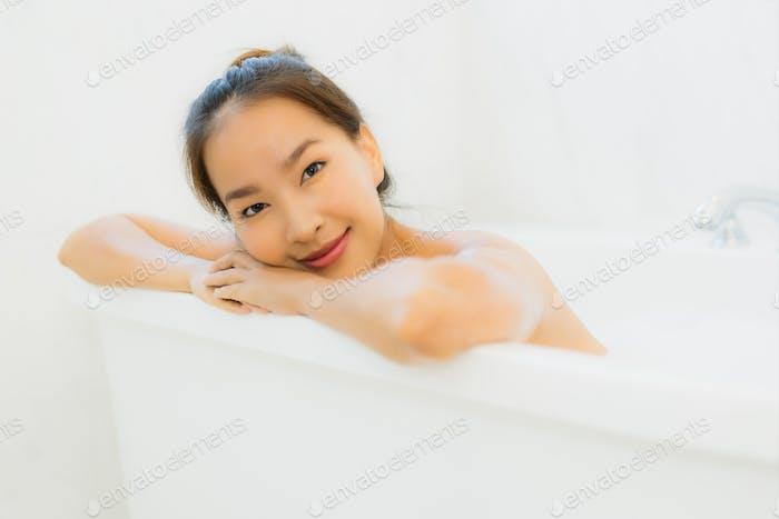 Portrait beautiful young asian woman take a bathtub in bathroom