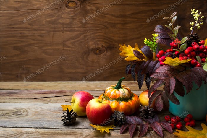 Thanksgiving arrangement with rowan in turquoise vase, copy spac