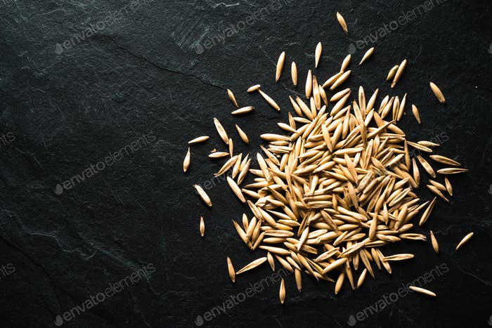 Whole oats for germination on a stone table