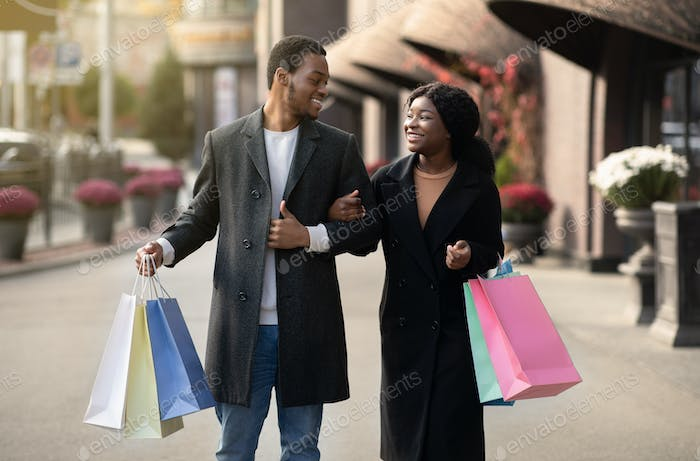 Walking in city for two and shopping in mall