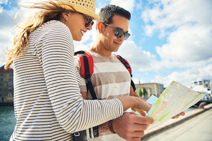 Young tourist couple looking at a map