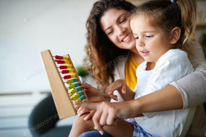Mother and little cute girl, kid playing with abacus, early education