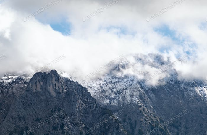 alpine rocks in clouds