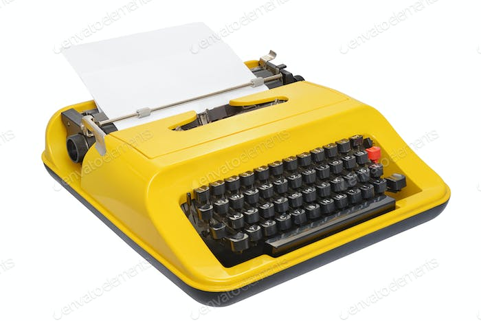 Yellow typewriter isolated on white background