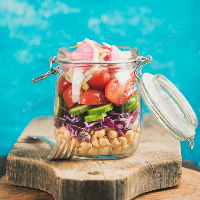 Vegetable and chickpea sprout vegan salad in jar, square crop