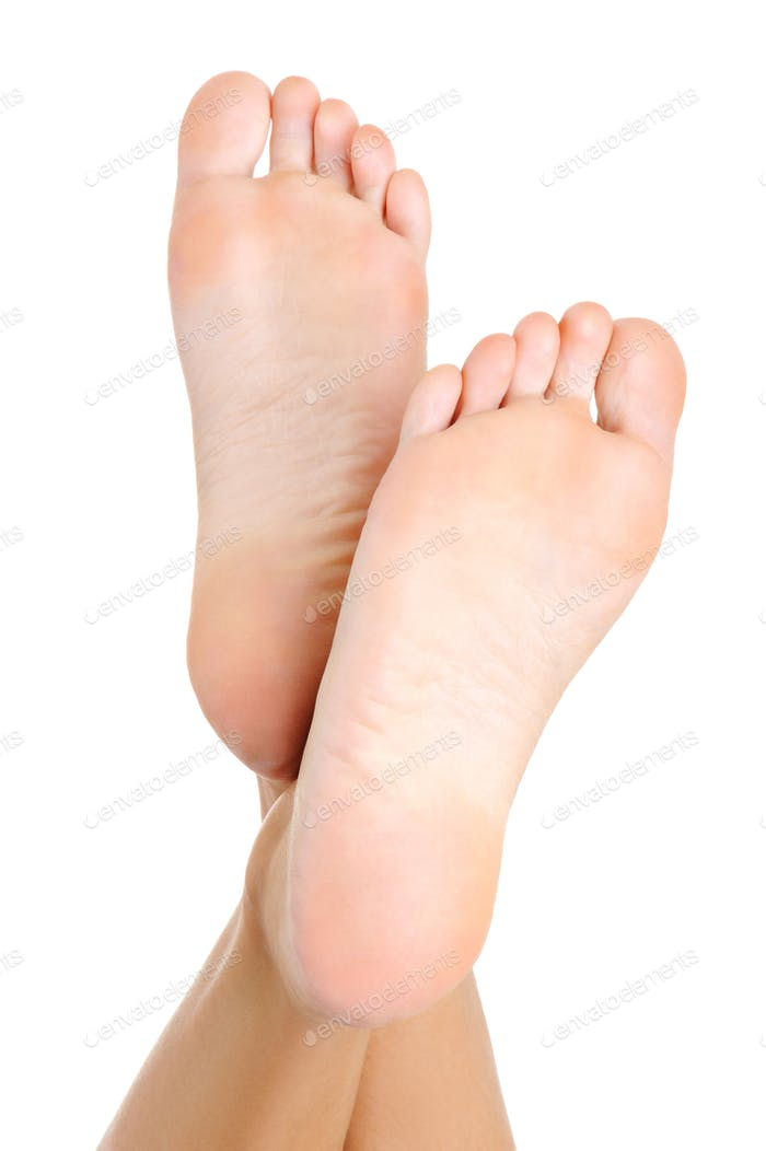 Beautiful pure well-groomed female a foot and a heel