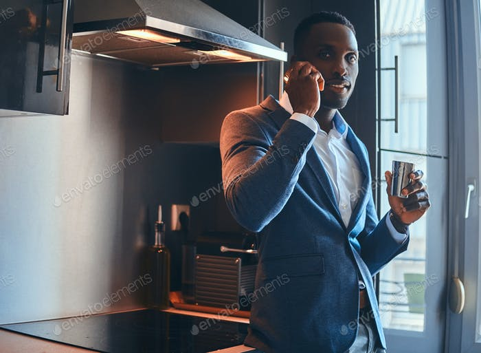 Concept of mourning routine - man has coffee at the kitchen