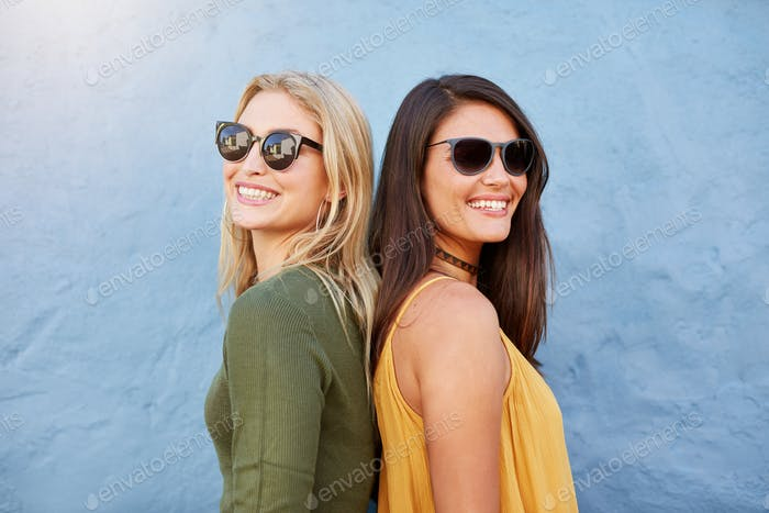 Stylish female friends wearing sunglasses