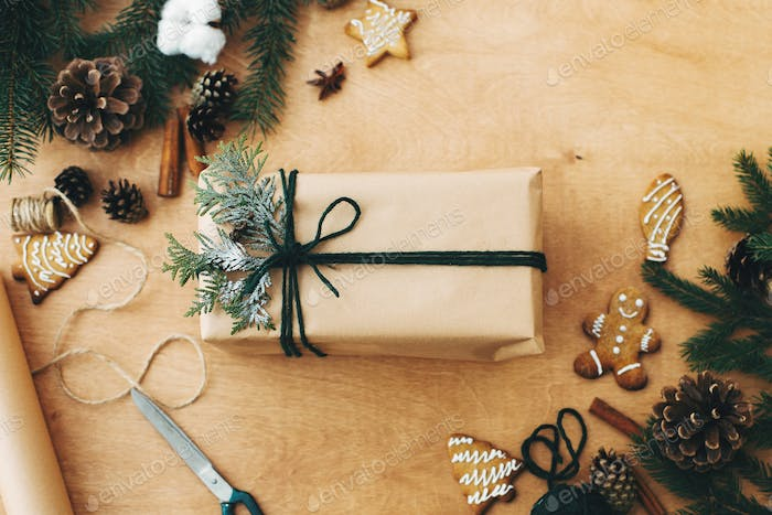 Merry Christmas flat lay. Stylish rustic christmas gifts box