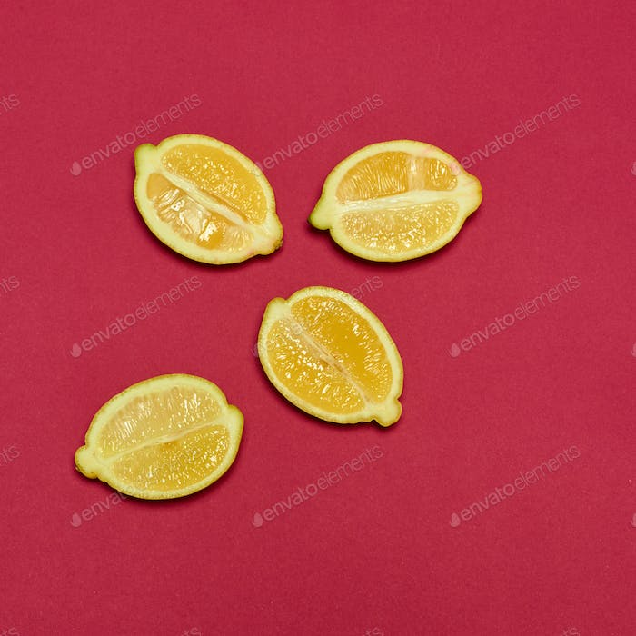 Lemons on red background