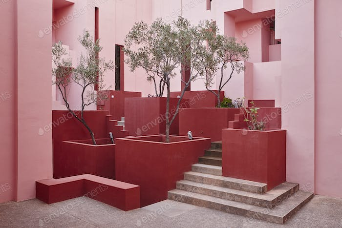 Geometric building design. The red wall, La manzanera. Calpe, Spain