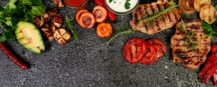 Banner with Steak pork grill with a variety of grilled vegetables