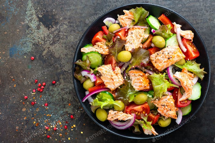 Salad with fish. Fresh vegetable salad with salmon