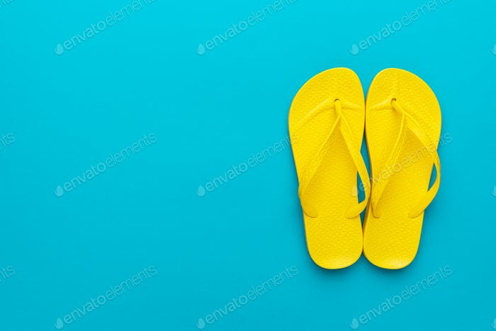 Yellow Beach Flip-Flops On The Blue Background
