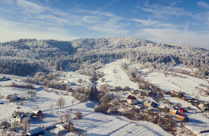aerial view of a small town in the mountains during winter