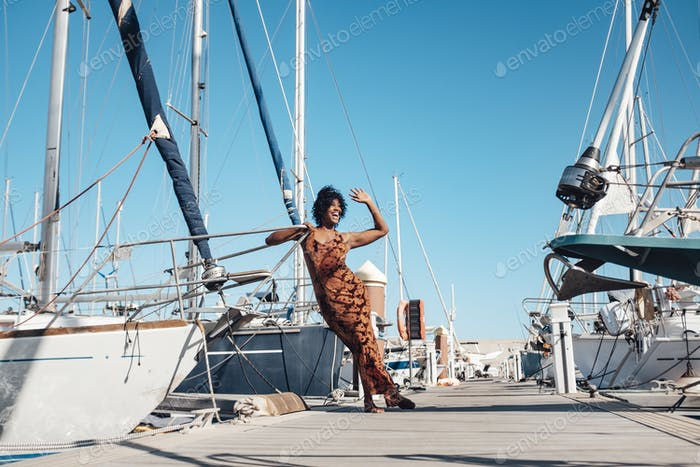 Happy and cheerful young black woman outdoor