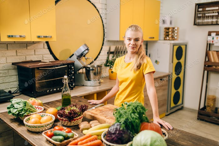Young woman cooking on the kitchen, healthy food