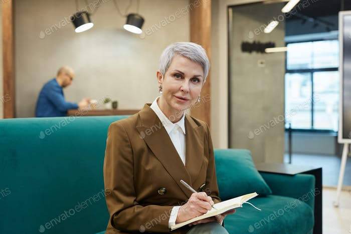Modern Mature Businesswoman Looking at Camera