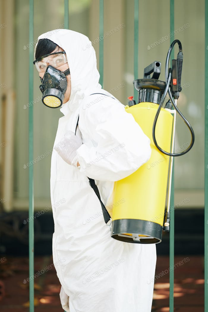 Professional technician in a protective suit