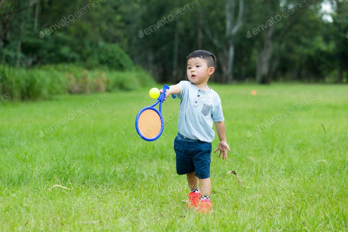 Small kid play with tennis