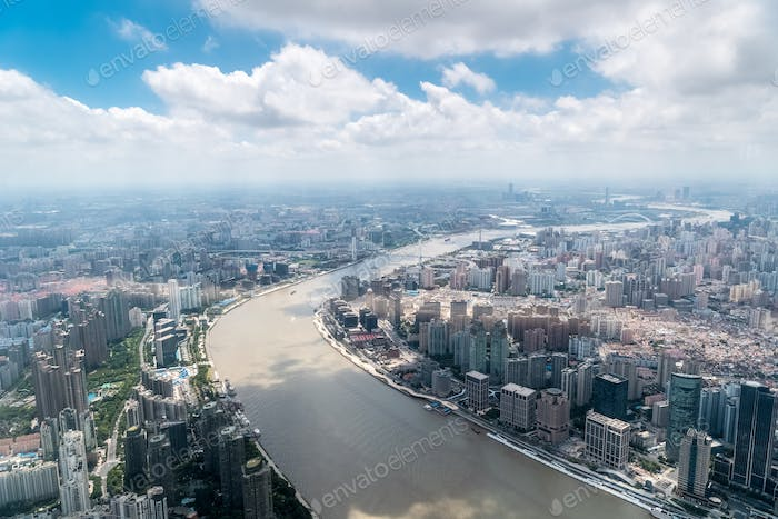 aerial view of shanghai cityscape, winding huangpu river through the city