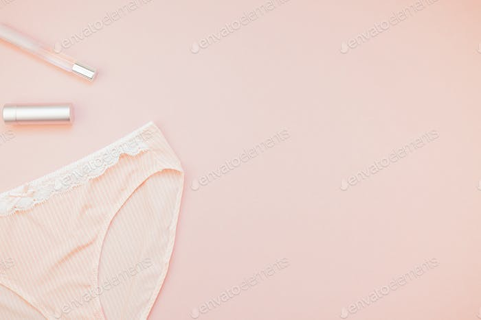 Flat lay set of female panties and accessories