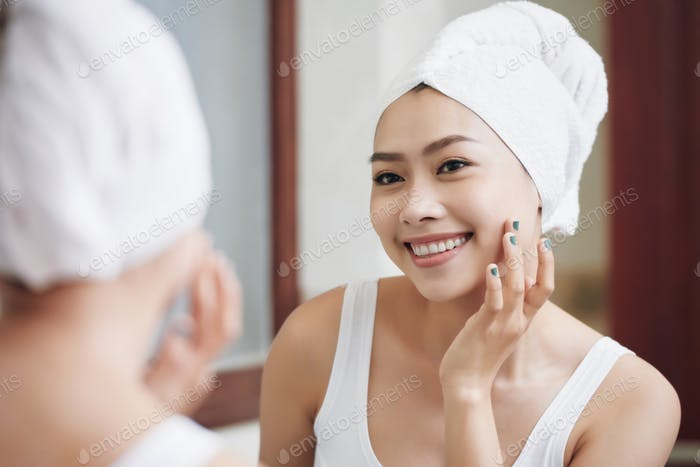 Content Asian woman with flawless skin