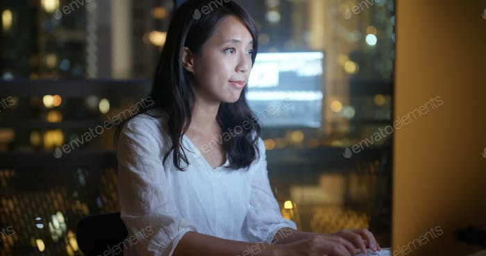 Woman working over night on computer