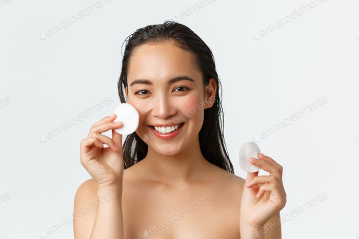 Skincare, women beauty, hygiene and personal care concept. Close-up of beautiful asian girl standing