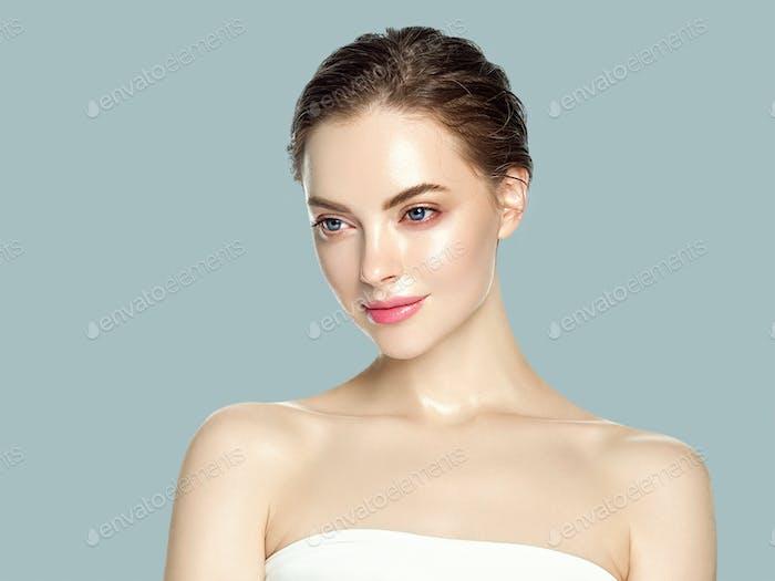Beautiful woman healthy skin care concept portrait close up gray background. Studio shot.