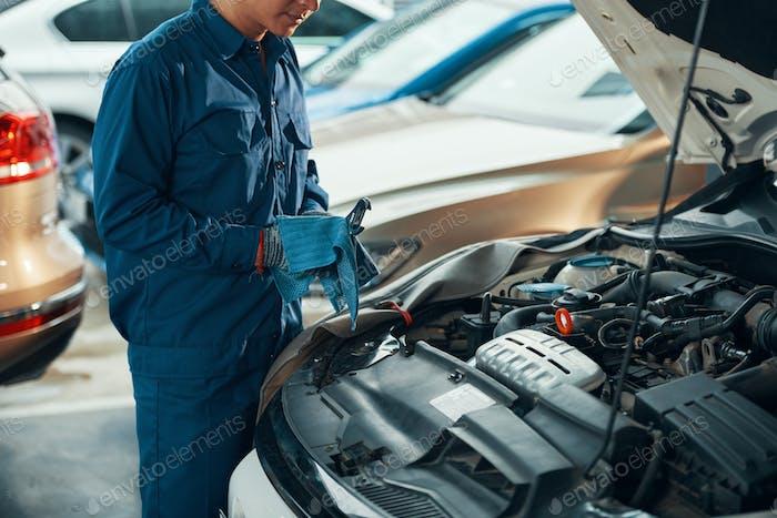 Car mechanic wiping wrench