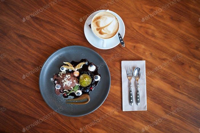 chocolate ice cream dessert on plate at restaurant