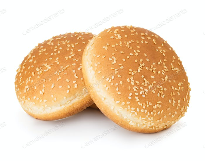 Two hamburger buns with sesame isolated on white background.