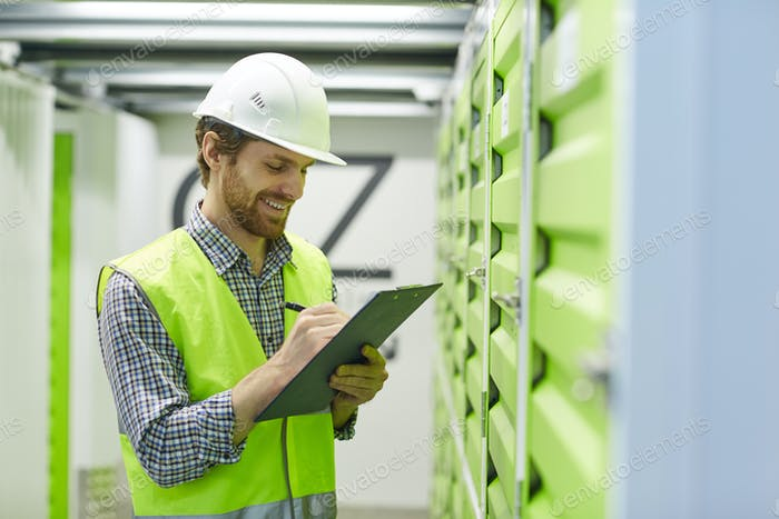 Foreman working with documents in storage