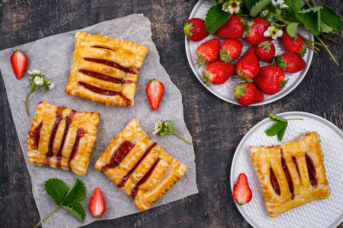 Sweet puff pastry cakes with strawberry
